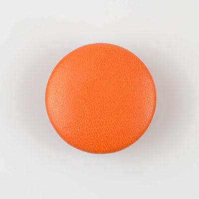 Guzik pomarańczowy obciągany skórą cielęcą 38 mm