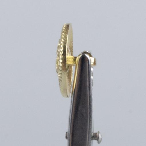 Guzik z herbem i ozdobną obwódką kolor złoty śr. 16 mm