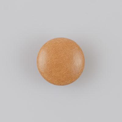 Guzik obciągany sztuczną skórą w kolorze beżowym, śr. 21 mm