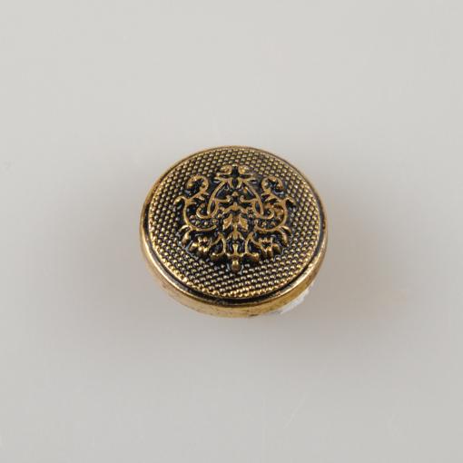 Guzik ozdobny w stylu retro z herbem florystycznym - tribalowym w kolorze starego złota, średnica 15 mm.