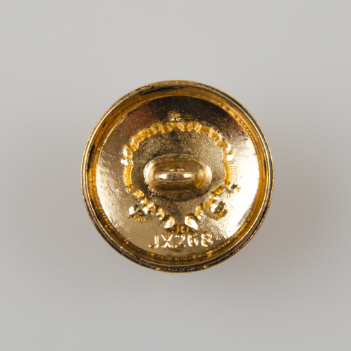 Guzik ozdobny w stylu retro z herbem florystycznym - tribalowym w kolorze starego złota, średnica 20 mm.