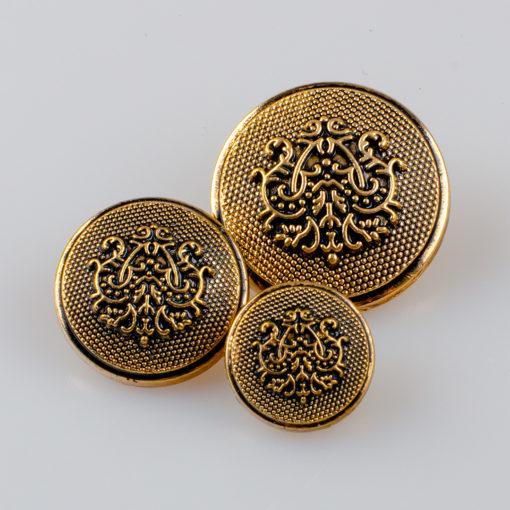 Guzik ozdobny w stylu retro z herbem florystycznym - tribalowym w kolorze starego złota, średnica 15, 20, 25 mm.
